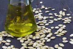 Pumpkin seed oil in glass bottle Stock Photos