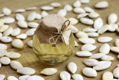 Pumpkin seed oil in glass jar Royalty Free Stock Images