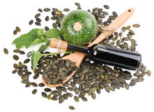 Pumpkin seed oil, raw pumkin and seeds, view from above Stock Image