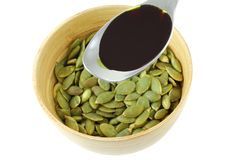 Pumpkin Seed Oil and Roasted Pumpkin Seeds Royalty Free Stock Image