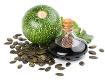 Pumpkin seed oil with seeds and plant Royalty Free Stock Images