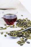 Pumpkin seed oil and seeds Stock Photo