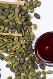 Pumpkin seed oil and seeds Royalty Free Stock Images