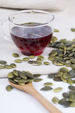 Pumpkin seed oil and seeds Royalty Free Stock Photos