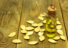 Pumpkin seed oil on wooden background Royalty Free Stock Photography