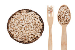 Pumpkin seed in a plate, fork and spoon Stock Photo