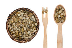 Pumpkin seed in a plate, fork and spoon Royalty Free Stock Photo