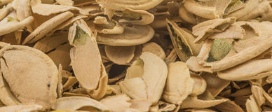 Pumpkin seed shells. A set of pumpkin seed shell heaps Stock Photo