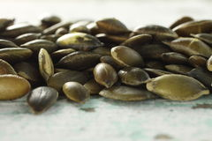 Dried pumpkin seeds. A pile of dried pumpkin seeds Royalty Free Stock Photos