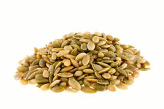 Pumpkin seeds. Pile of pumpkin seeds on white background Stock Image