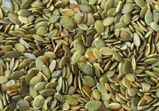 Pumpkin seeds. Many of pumpkin seeds royalty free stock photos