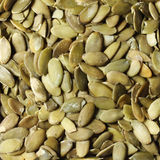 Pumpkin seeds background. Peeled Stock Photo