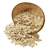 Pumpkin seeds in basket Stock Photo