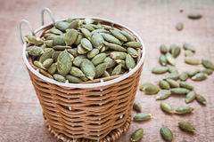 Pumpkin seeds in basket Royalty Free Stock Images