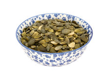 Pumpkin seeds in a blue and white china bowl Royalty Free Stock Photography