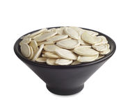 Pumpkin seeds in bowl Stock Photos