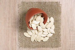 Pumpkin seeds in bowl Royalty Free Stock Images