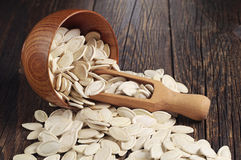 Pumpkin seeds in bowl with a spoon Royalty Free Stock Image