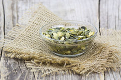 Pumpkin seeds in a bowl Stock Images
