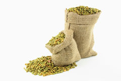 Pumpkin seeds in burlap bags. Royalty Free Stock Photos