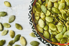 Pumpkin seeds in a ceramic bowl Royalty Free Stock Photo