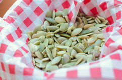 Pumpkin seeds in cloth. Peeled pumpkin seeds in cloth Royalty Free Stock Photos