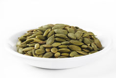 Pumpkin seeds on dish Stock Images