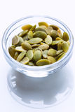 Pumpkin seeds in the glass bowls Stock Photography