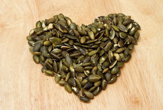 Pumpkin seeds in heart shape Royalty Free Stock Photos