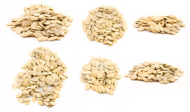 Pumpkin seeds isolated. A set of pumpkin seed heaps isolated on white background Royalty Free Stock Photo