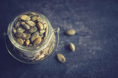 Pumpkin seeds in the jar Stock Images