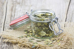 Pumpkin seeds in a jar Stock Images