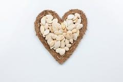 Pumpkin seeds  lies at the heart made of burlap Royalty Free Stock Photo