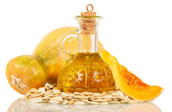 Pumpkin seeds and oil isolated on white. Background Royalty Free Stock Photo