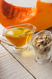 Pumpkin seeds and oil Royalty Free Stock Image