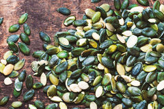 Pumpkin seeds over wooden table with copy space Stock Image
