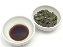 Pumpkin seeds and pumpkin seed oil Royalty Free Stock Photo