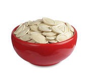 Pumpkin seeds in red bowl Royalty Free Stock Photos