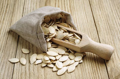 Pumpkin seeds in a sack Royalty Free Stock Image