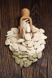 Pumpkin seeds in scoop Stock Photography