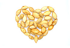 Pumpkin seeds in shape of heart Stock Photos