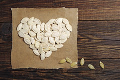 Pumpkin seeds in the shape of hearts Stock Image