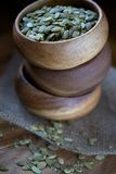 Pumpkin Seeds in Soft Light in Three Stacked Wood Bowls Stock Images
