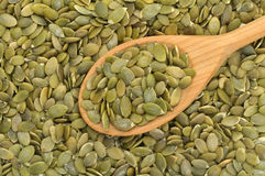 Pumpkin seeds with spoon Royalty Free Stock Image