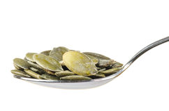 Pumpkin seeds in a spoon Stock Images