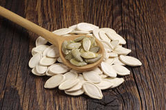 Pumpkin seeds in spoon Royalty Free Stock Images