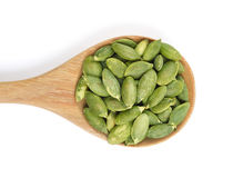 Pumpkin seeds in the spoon. On white background stock photo