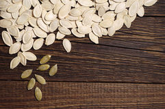 Pumpkin seeds on table Stock Image