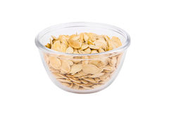 Pumpkin seeds in a transparent bowl isolated on white background Royalty Free Stock Image