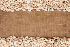 Pumpkin seeds were lying on sackcloth Stock Photo
